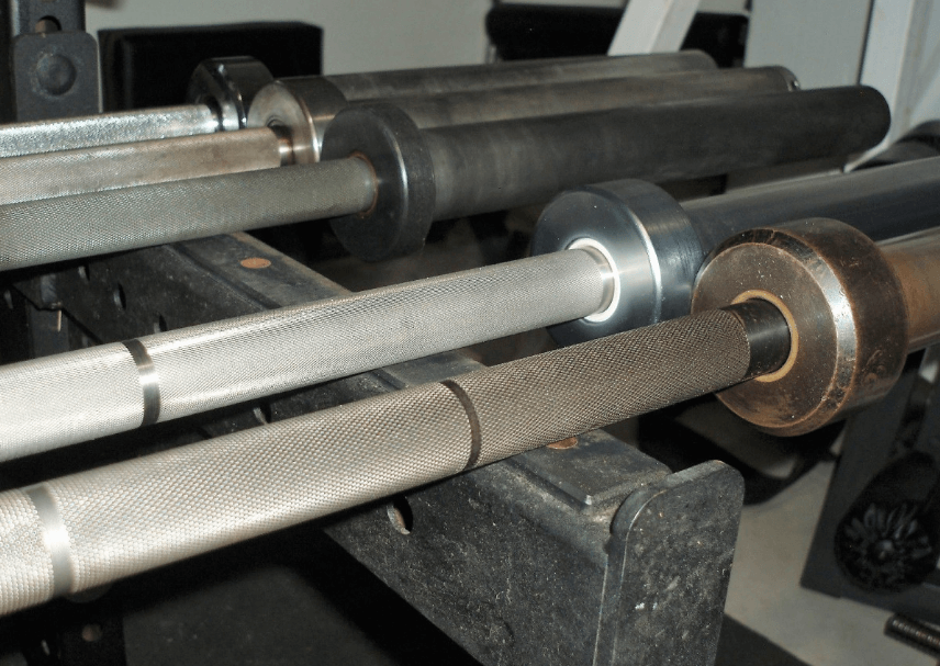 The Olympic barbell is stronger, heavier and used in more intense weight lifting