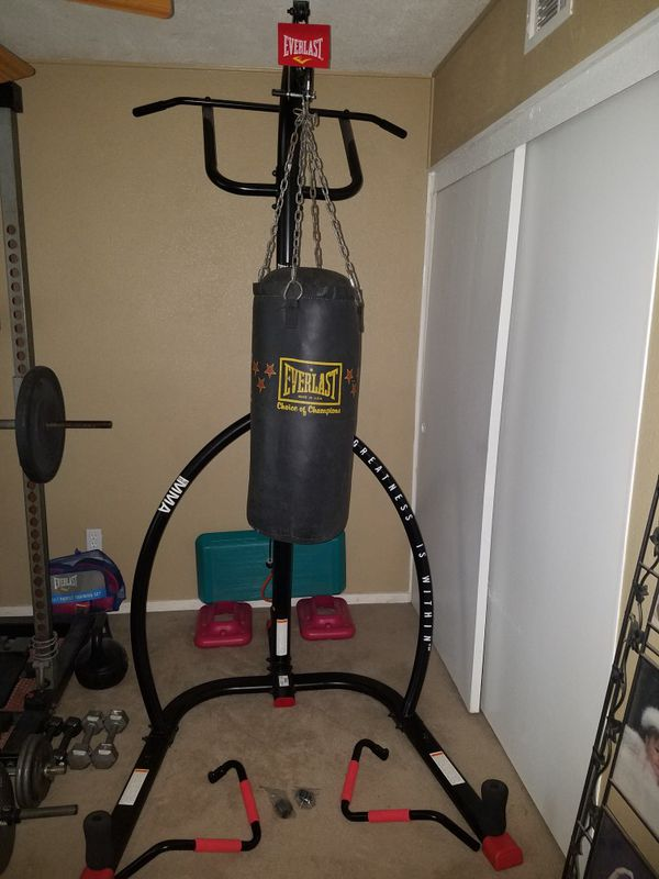 Why you should only buy a punching bag stand with a pull up bar - It Saves Room