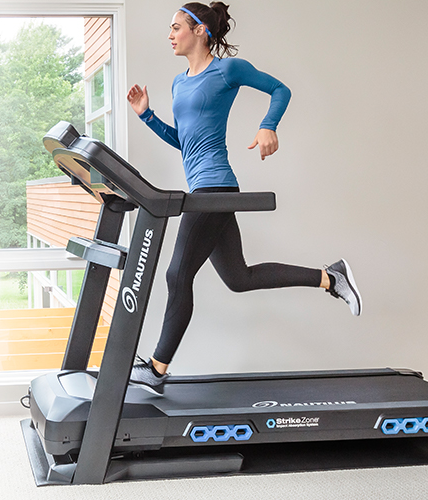 A woman running on The Nautilus T616