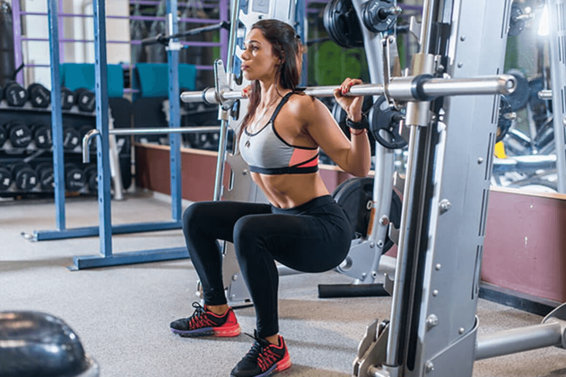 One of the benefits of the Smith Machine Squat is focusing on form