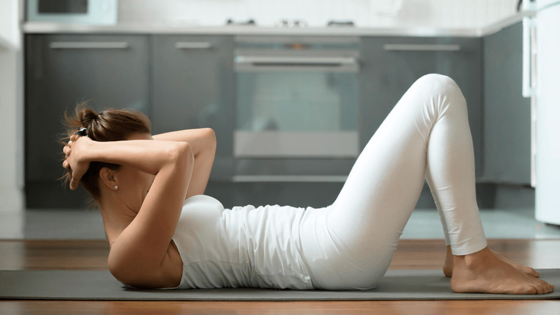 A Mistake People Make when Doing Double Crunches Is Yanking Their Head