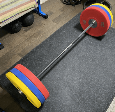 Our choice for the best short barbell on the market, the Rogue C-60B Bar and Bumper Set