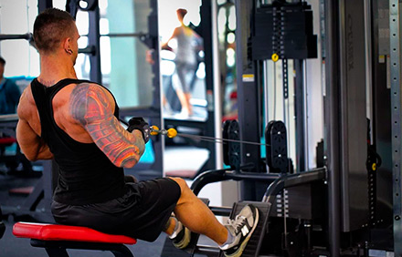Both lat pulldowns and seated rows can be used for upper body development