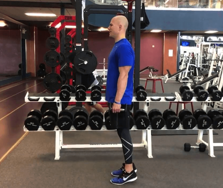 How to perform the standing calf raise with dumbbells