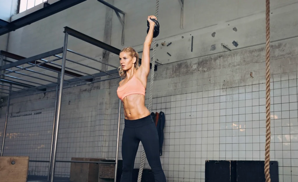 Single arm kettlebell snatch works several muscles